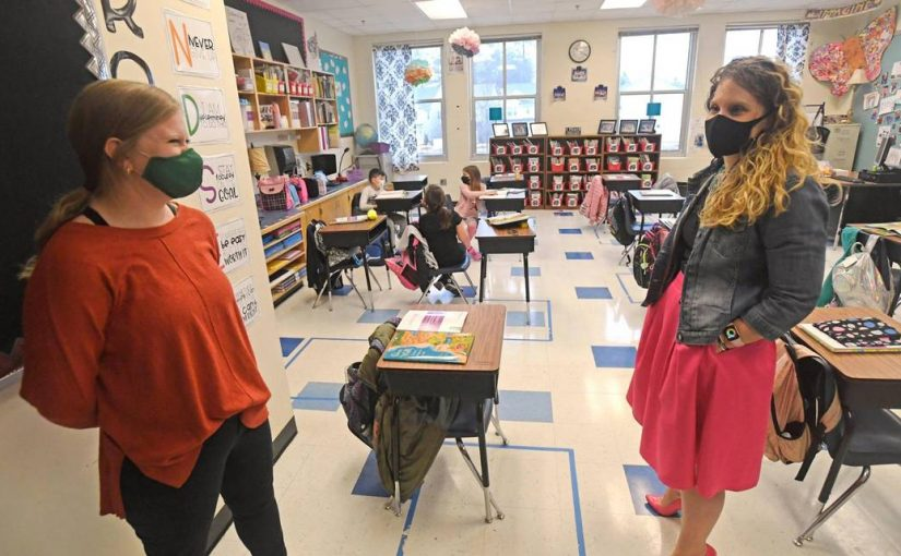 The Charlotte Observer – Student? Teacher? Both. 'Zero regrets' for first-time teachers in CMS during COVID